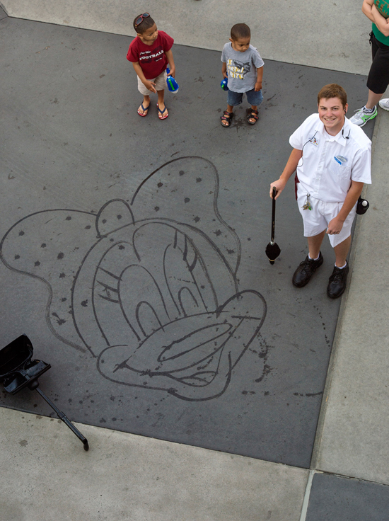 Hayes is One of 15 or so Cast Members Who Has Learned to 'Paint' Mickey, Minnie and Other Classic Disney Characters Using Nothing More Than His Broom and Water