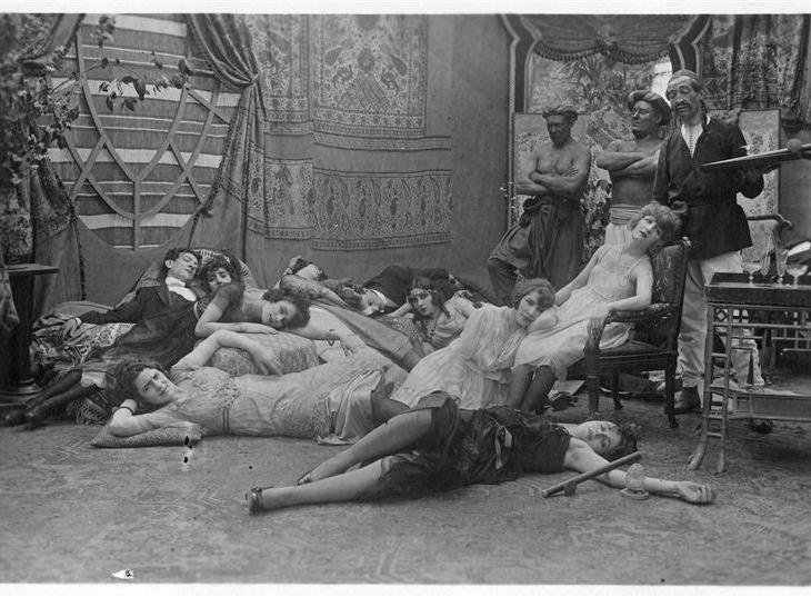 Women on the floor smoking opium and three eunuchs watching them: Broquin, Max the Eunuch and Footitt
