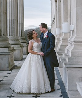 A couple pictured on the balcony of Parliament Buildings at their wedding reception.