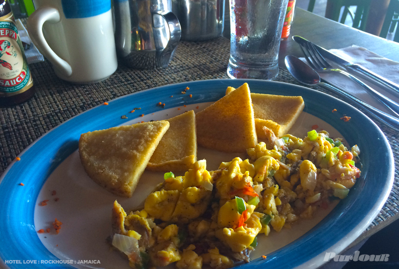 A proper Jamaican breakfast: bammy, ackee & saltfish. Pick-a-peppa sauce on the side.