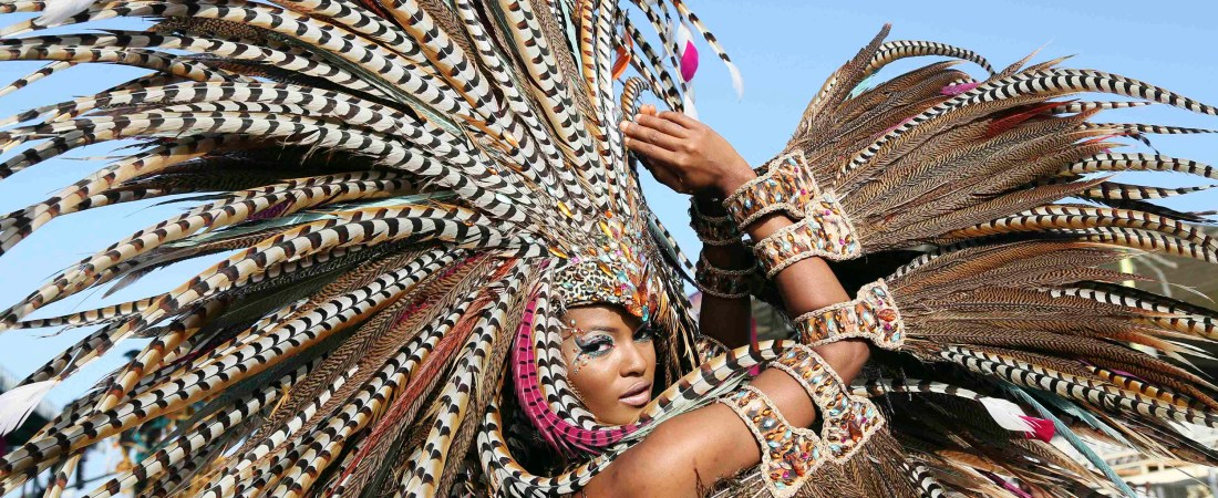 """Trinidadian model Soowan Bramble performs in an individual mas costume during Hart's Carnival 2014 presentation """"Of Love and War,"""" as the band crosses the stage at the Queen's Park Savannah on the final day of the parade of bands in the annual Carnival festival, in Port-of-Spain, March 4, 2014. REUTERS/Andrea De Silva (TRINIDAD AND TOBAGO - Tags: ENTERTAINMENT SOCIETY)"""