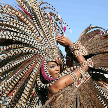 "Trinidadian model Soowan Bramble performs in an individual mas costume during Hart's Carnival 2014 presentation ""Of Love and War,"" as the band crosses the stage at the Queen's Park Savannah on the final day of the parade of bands in the annual Carnival festival, in Port-of-Spain, March 4, 2014. REUTERS/Andrea De Silva (TRINIDAD AND TOBAGO - Tags: ENTERTAINMENT SOCIETY)"