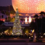 """EPCOT LIGHTS UP THE HOLIDAY NIGHTS: The giant Christmas tree at Epcot, seen with the park's iconic Spaceship Earth attraction behind it, is the centerpiece of the holiday celebration at the theme park in Lake Buena Vista, Fla. It's all part of the Walt Disney World theme park's annual """"Holidays Around the World"""" celebration, in which international traditions of the season unfold all throughout World Showcase."""