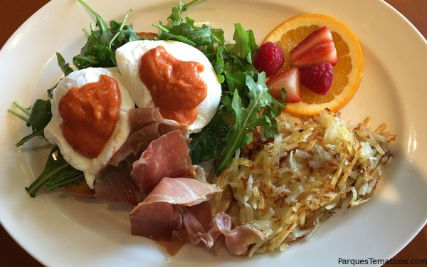 Eggs Beneditto – Poached eggs, prosciutto, arugula, ciabatta, tomato hollandaise and potato hash make for one scrumptious dish.