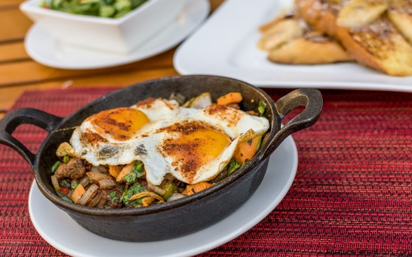 Paleo Smoked Brisket Hash – Slowly smoked beef brisket, sweet potato, onion and peppers, two sunny side up eggs and a side of avocado and tomato-arugula salad.