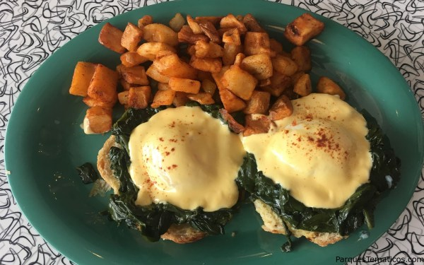 Poached Eggs on Gouda Swirl – Baby spinach, hollandaise sauce and breakfast potatoes round it out for a hearty dish.