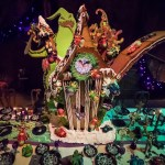 "HAUNTED MANSION HOLIDAY GINGERBREAD HOUSE – Now through January 2018, Haunted Mansion Holiday brings the frightfully fun cheer of ""Tim Burton's Nightmare Before Christmas"" to the Disneyland Resort. This year, Oogie Boogie causes mischief by peeling back the roof of a gingerbread Haunted Mansion to reveal gummy bugs and worms during the 17th season of this festive tradition in the mansion's ballroom."