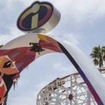 "INCREDIBLES PARK IN PIXAR PIER (ANAHEIM, Calif.) - Inspired by ""The Incredibles"" and ""Incredibles 2,"" Incredibles Park features mid-century modern design aesthetics. Guests will enter through an archway where the iconic Incredibles logo will be seen overhead. Once inside, the new Incredicoaster will take guests on a thrilling race alongside the Parr family. Upon exiting the attraction, the Jack-Jack Cookie Num Nums stand will tempt guests with freshly-baked treats."