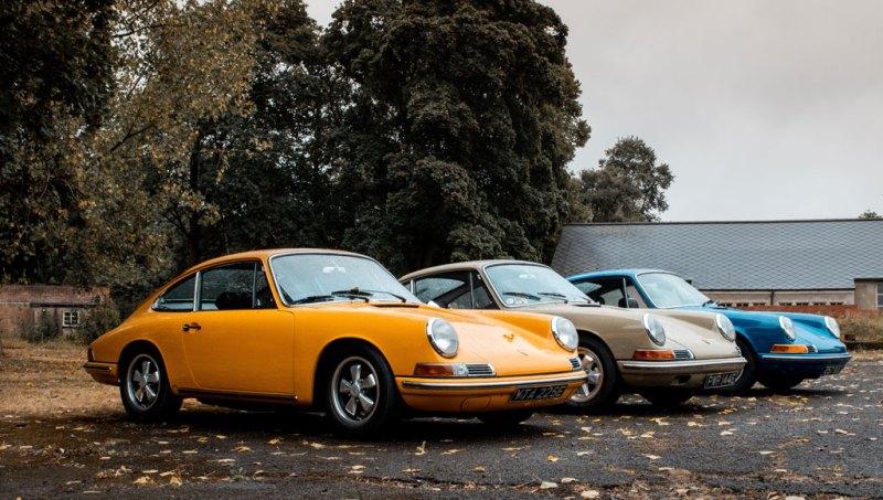 Classic Porsche car in orange parked outside