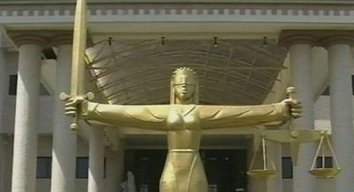 Woman drags three neighbours to court for calling her a witch