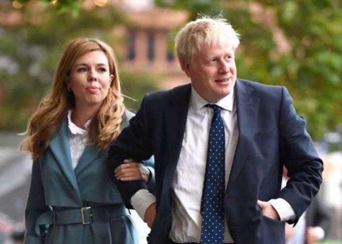 British premier's pregnant fiancée tests positive
