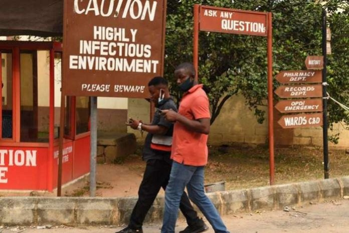 Patients battle coronavirus 'enemy' in Nigeria second wave