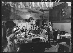 New York, New York. The Di Costanzo family, owners of a restaurant on Mulberry Street, hold their annual family dinner in the restaurant on New Year's Eve. Gypsy friend who comes to eat, dances to entertain them