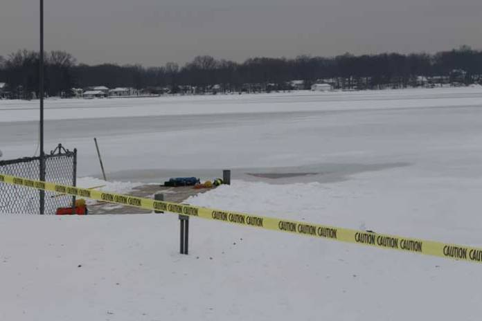 The volunteers cut a hole in the ice on Lake Parsippany getting ready to practice dive drill in case of an emergency