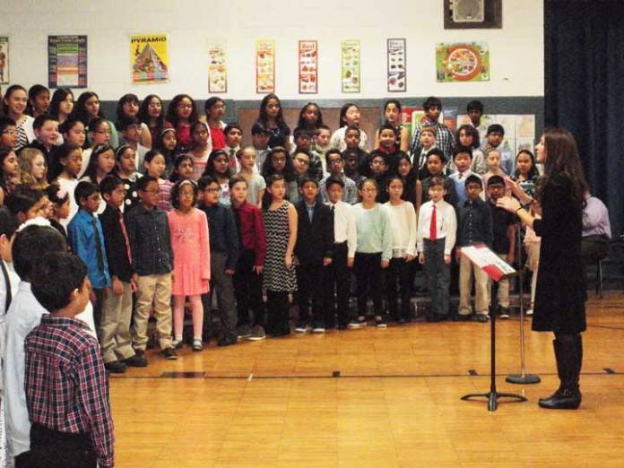 Miss Kristin Kirbos, Chorus Director with Northvail students