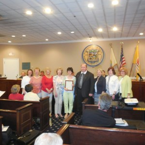 Club members accepting proclamation from Mayor Barberio