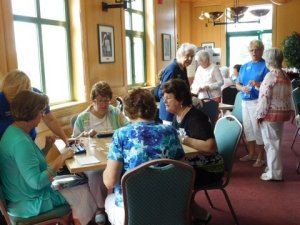 Women from several area Women's Clubs enjoyed a morning of games and socializing before the luncheon.