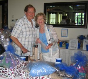 Club member MaryAnn Coyne and husband Bill looking at some of the 63 fabulous Tricky Tray items.