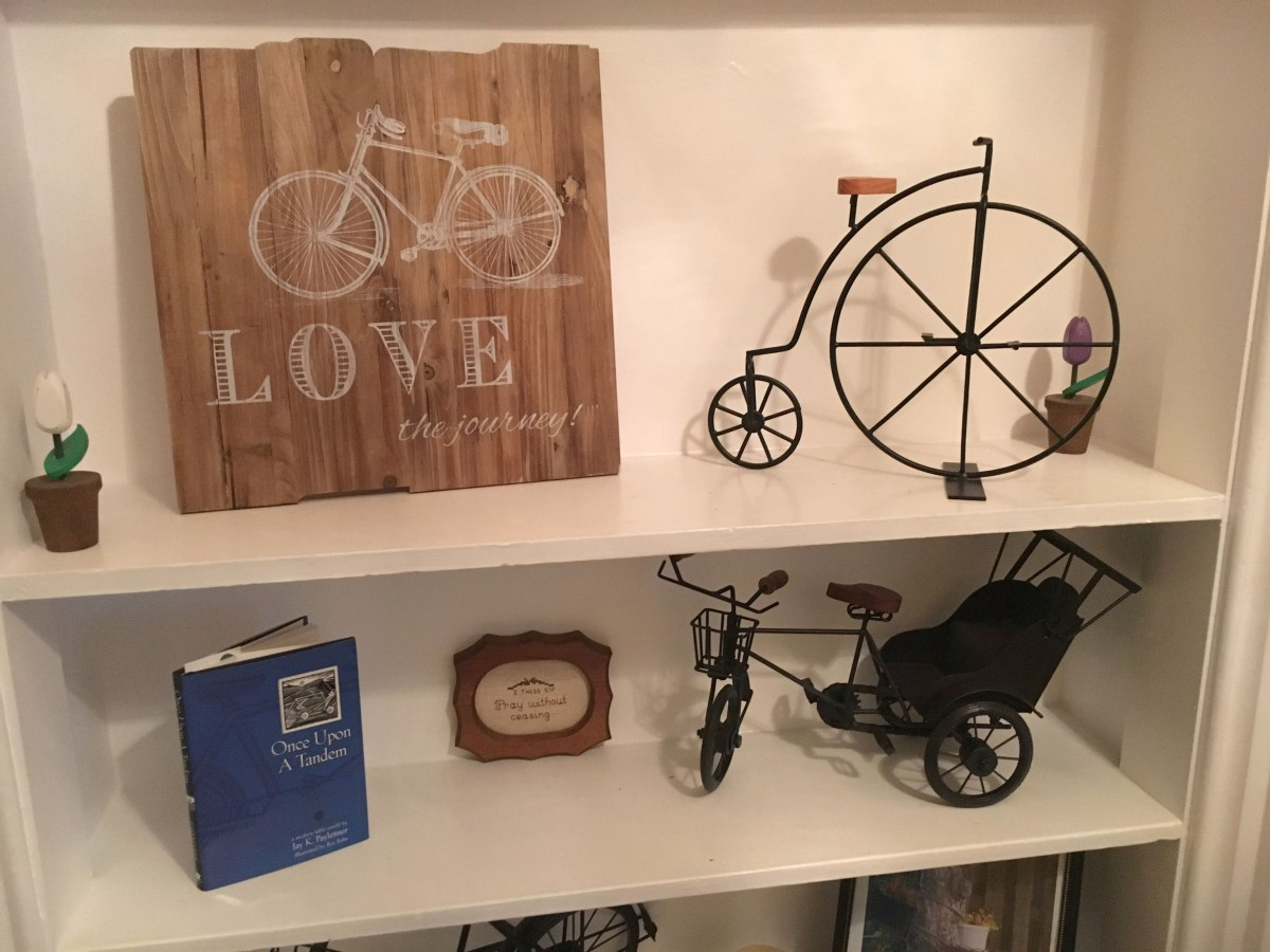 shelves with bicycle sculptures and other trinkets