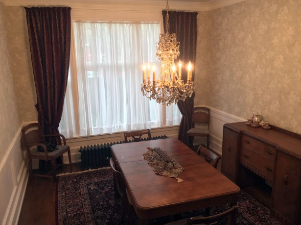 the dining room chandelier, with table, chairs, and buffet