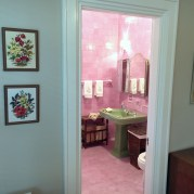 pink bathroom as seen through doorway from room 3