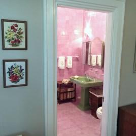 pink bathroom as seen through doorway from room 3