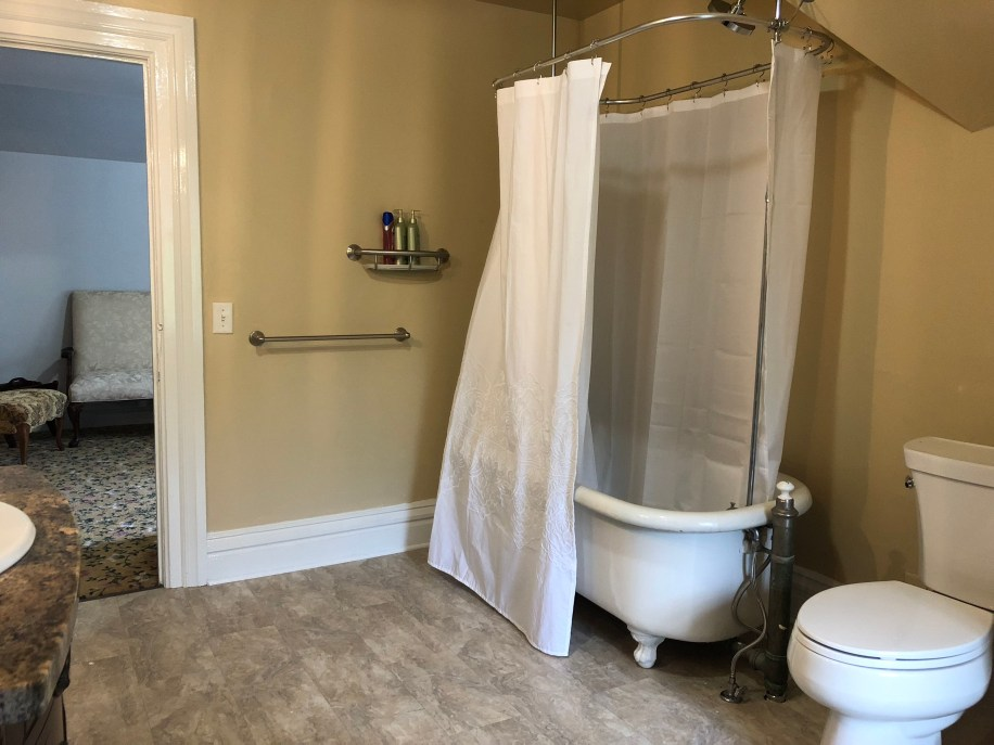 Claw-foot tub and shower on third floor