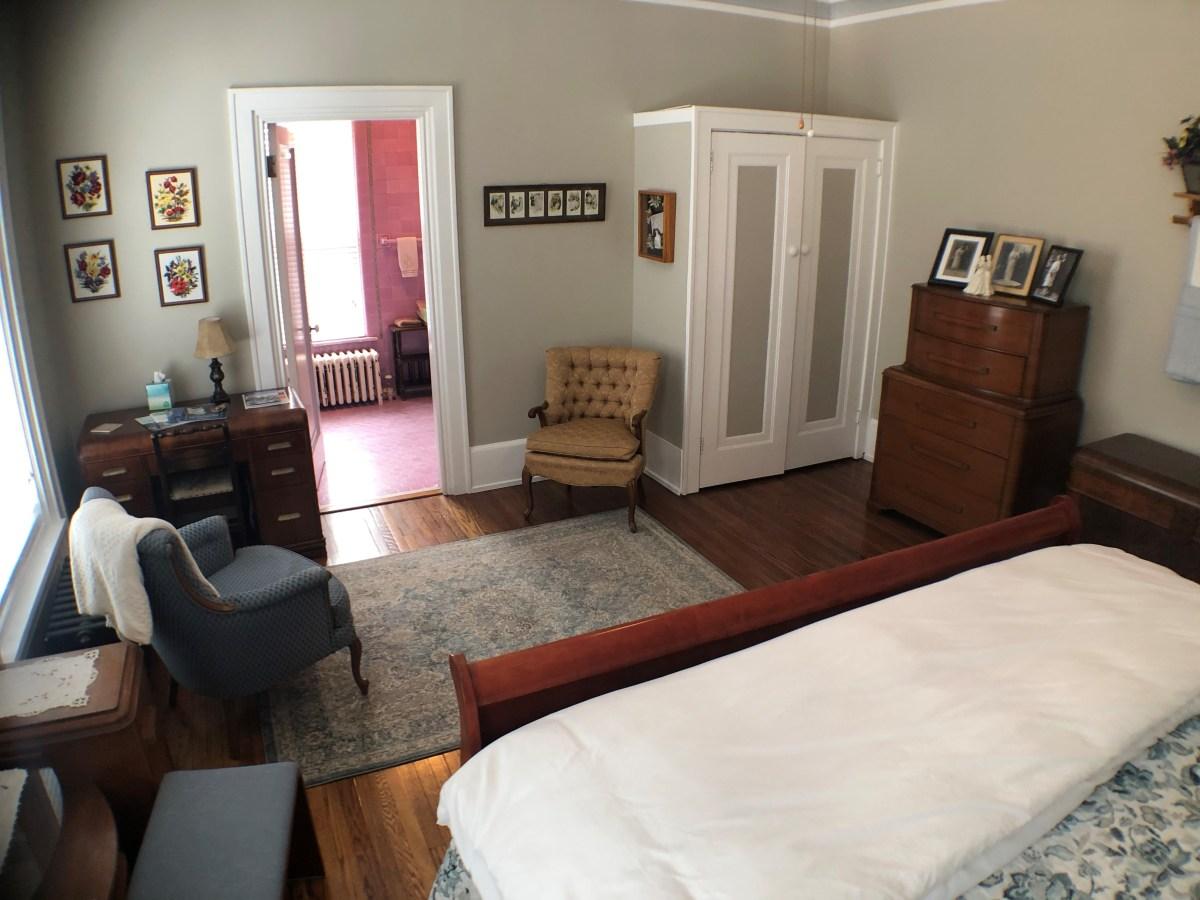 View of room 3 including desk, bathroom doorway, closet, and dresser