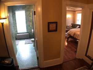 View of 2 doorways, Room 4 on the right and its bathroom next door on the left