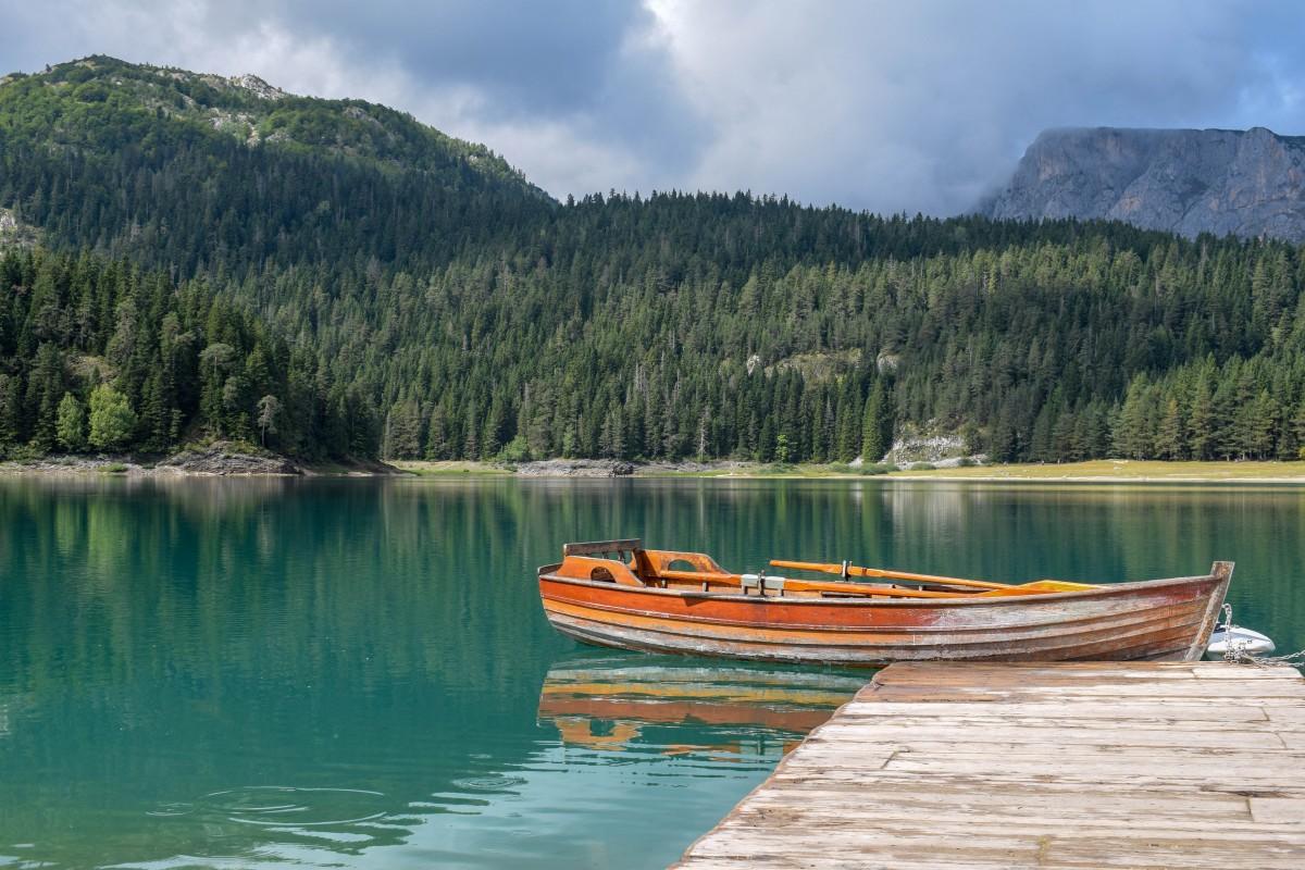 Canoe on Black Lake in Durmitor National Park in Montenegro - weekend break