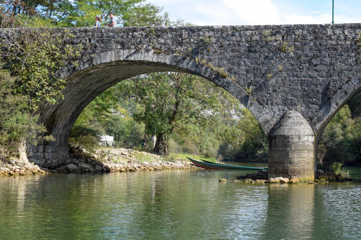 Lake skadar bridge and boat