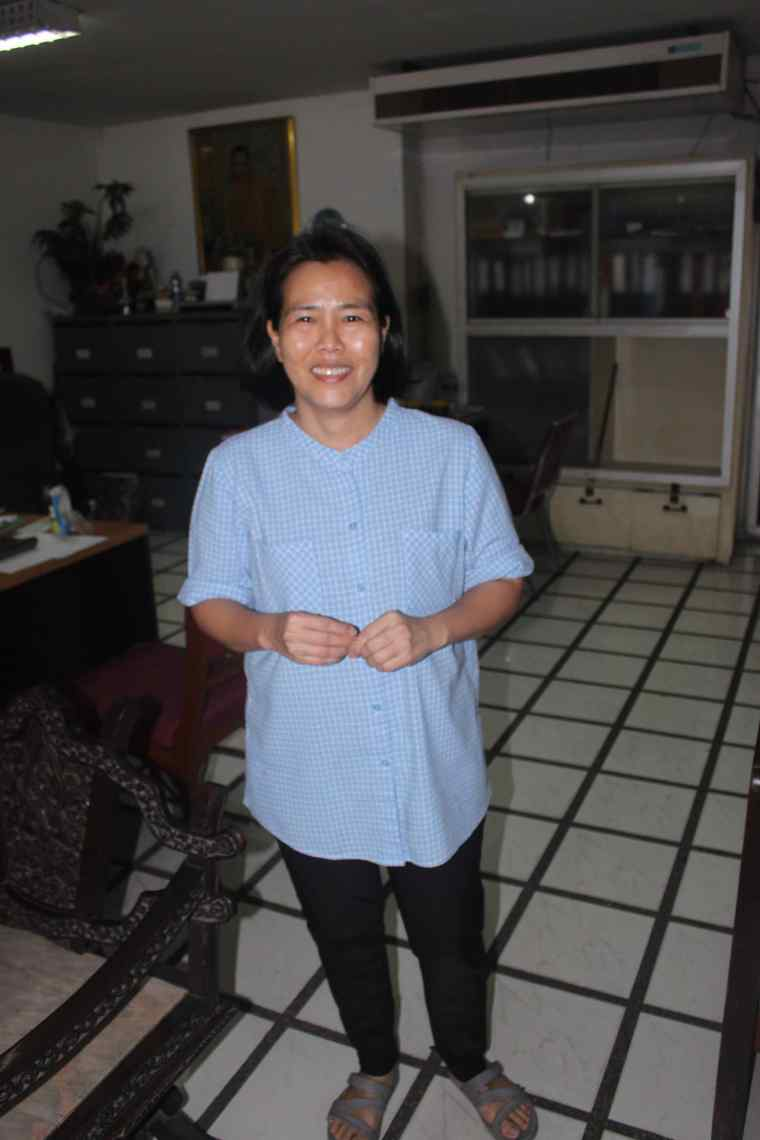 Khun Nok, the manager at P&P Grand Residence