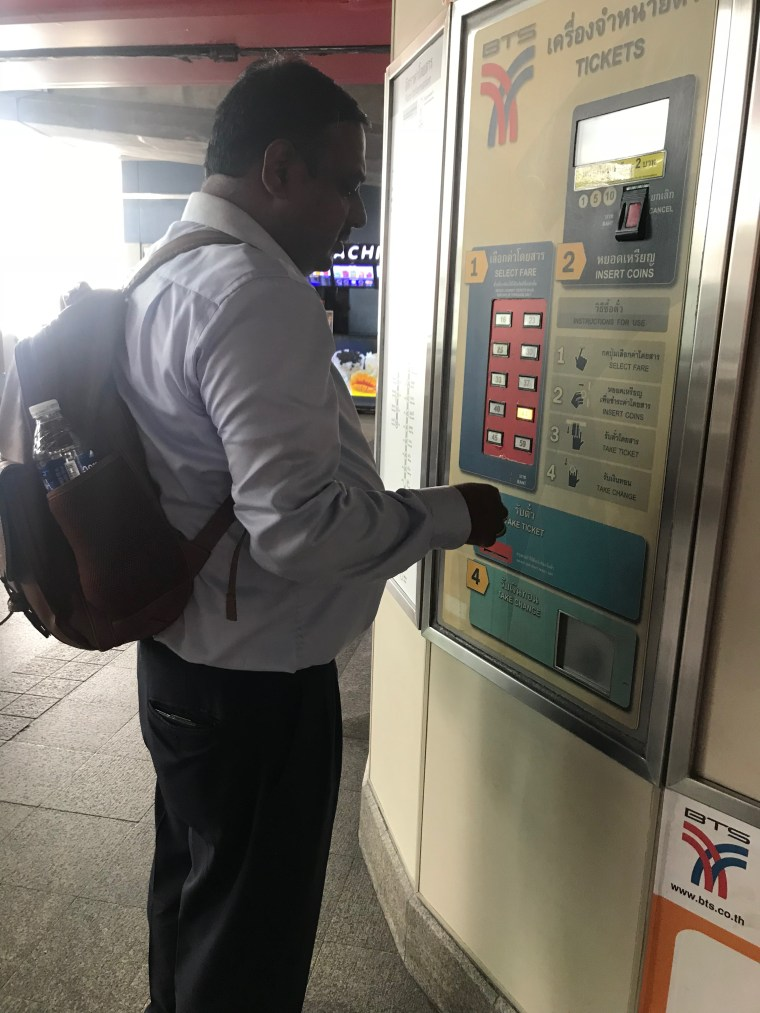 Buying Ticket from Ticket Vending Machine at Phrom Phong Metro Station