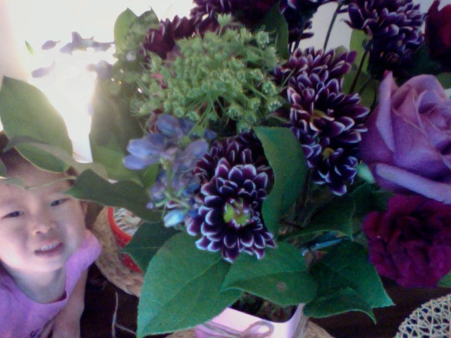 grateful for thoughtful friends who gave me these lovely flowers. =) my other little flower snuck her face into the pic.