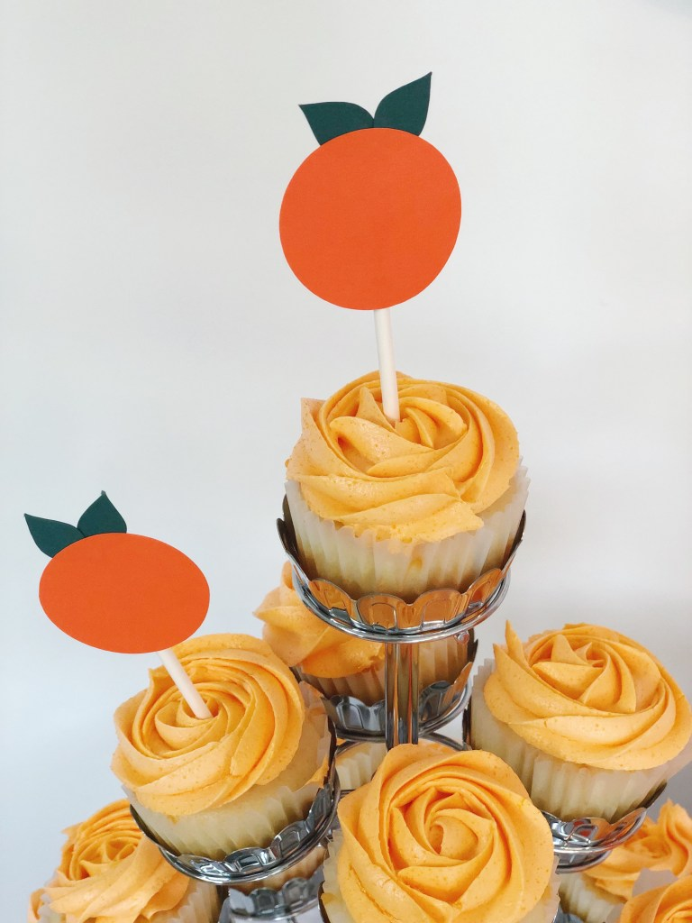 Interested in a cute, gender-neutral baby shower theme? This Little Cutie baby shower is so in right now and the perfect theme for your coming cutie!  I hope your momma-to-be loves oranges, the color and the fruit, because this fun baby shower theme idea is perfect for her!