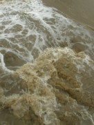 The raging, silt-filled waters of Bear Canyon Creek on September 12.