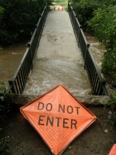 This footbridge over Bear Canyon Creek collapsed as one of it support pylons was washed out