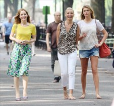 Actress Cameron Diaz, wearing a leopard top and white jeans with sandals, Leslie Mann and Kate Upton film 'The Other Woman' in Central Park in New York City