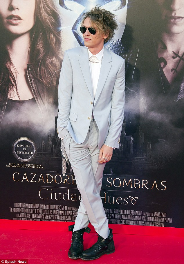 I adored this pale blue suit on him. The messy hair is just mouth-watering and not many guys could pull off this look.