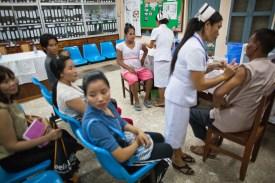 4.23 - Vientiane - MCH - UPS - man being vaccinated