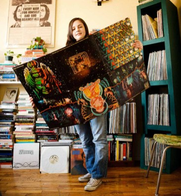 Margaret Barton Fumo, a vinyl record collector from Brooklyn, NY. Hawkwind's giant foldout cover for their live album Spaceritual ; photographed at her home for Dust & Grooves, a crate digging photo blog. www.dustandgrooves.com (C) All Rights Reserved to Eilon Paz & Dust & Grooves.