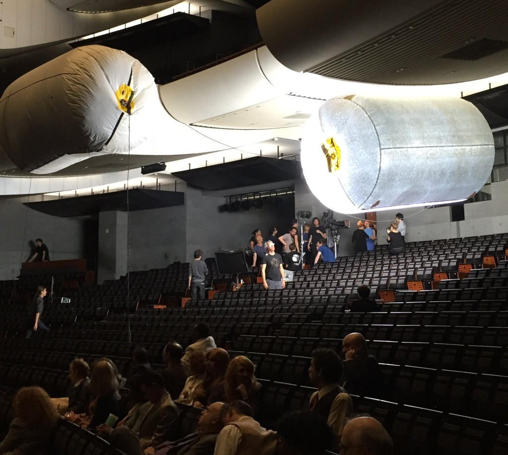 Lighting the rear of the auditorium for the exit shot; extras in foreground; balloons