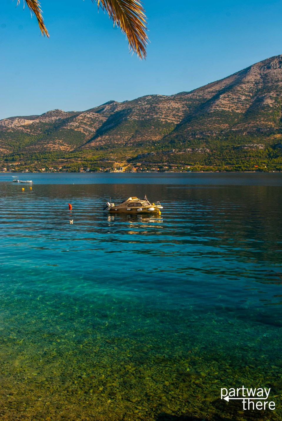 A boat floating in Korcula Harbor