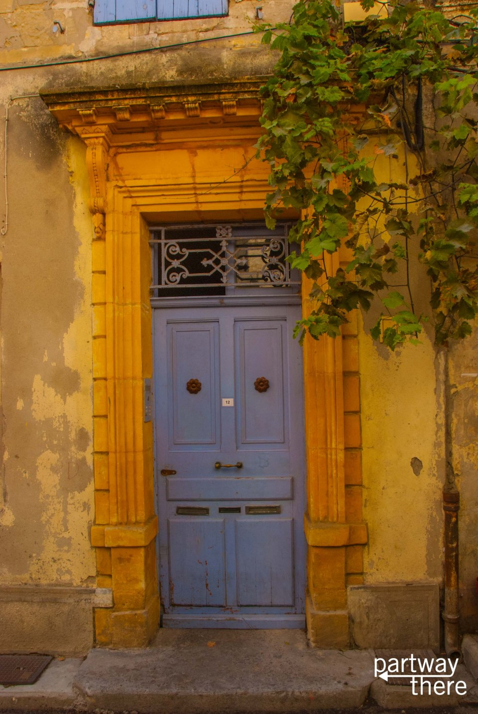 Gorgeous door painted in typical Provence colors in Arles, France