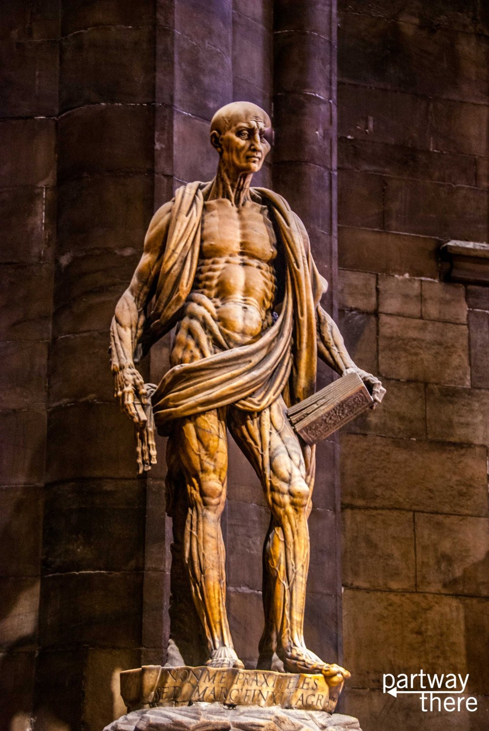 incredibly complex and detailed statue inside Milan Cathedral