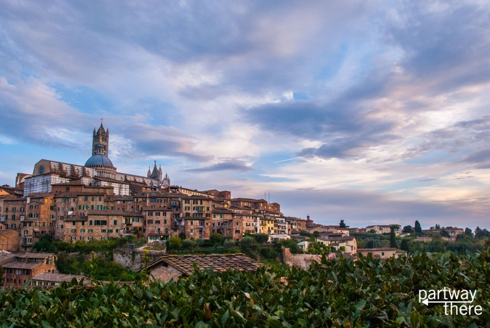 View of Siena Cathedral and upper old town at sunset