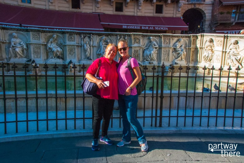 Amanda Plewes and Donna Plewes in front of fountain in Piazza del Campo in Siena, Italy
