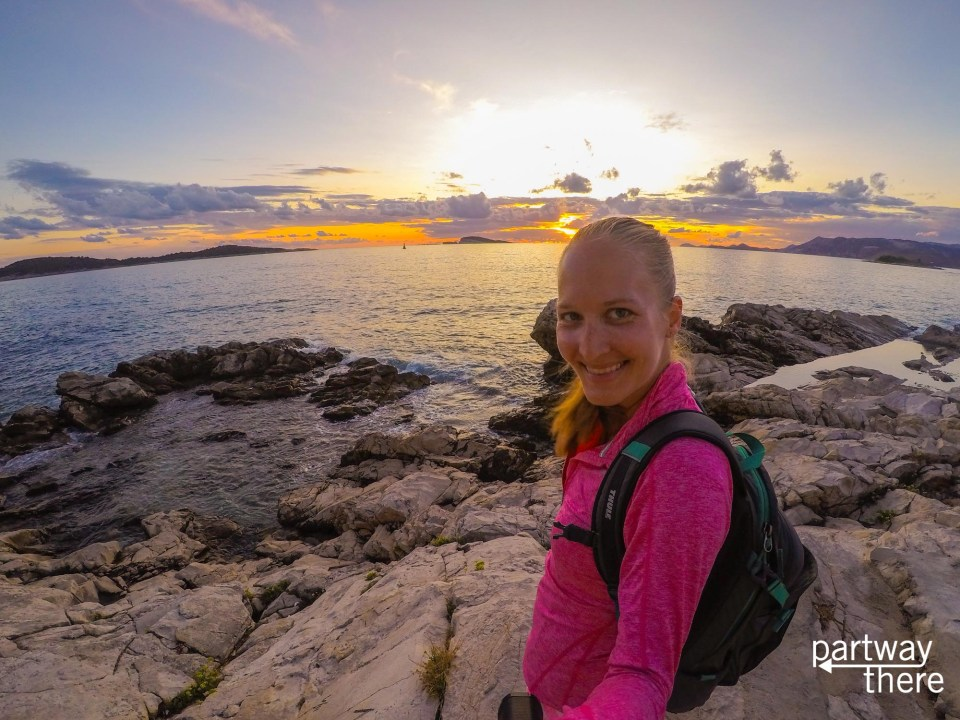 Amanda Plewes in front of the sunset in Cavtat, Croatia