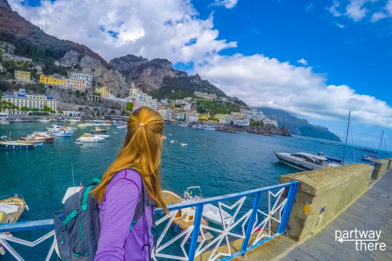 Amanda Plewes looking out at the town of Amalfi over the water