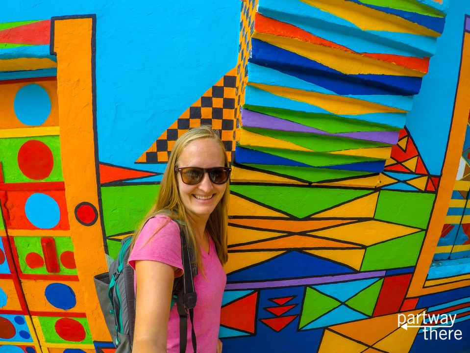 Amanda Plewes in front of a mural-painted house in Burano, Venice